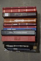Stock books containing World stamps,