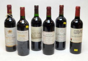 Six assorted bottles of claret.