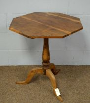 A 20th Century yew wood tripod table.