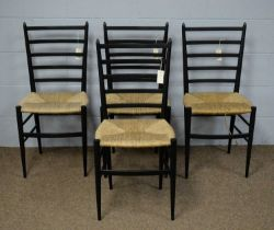A set of four dining chairs in the manner of Gio Ponti.