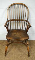 A 20th Century elm Windsor chair.