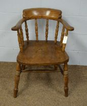 An early 20th Century elm captain's chair.