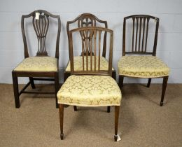 Four dining chairs.