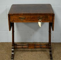 A 20th Century walnut side table.