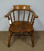 A late 19th Century elm captain's chair.