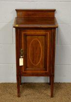 An Edwardian mahogany and inlaid nightstand.