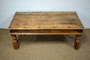 A 20th Century hardwood coffee table.