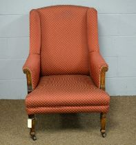 An early 20th Century wing back armchair.