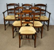 A set of six rush seat ladder-back dining chairs.