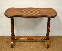 A Victorian walnut and inlaid games table
