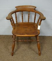 A 20th Century yew wood captain's chair.