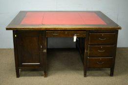 An early 20th Century oak partner's desk.