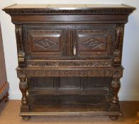 An 18th Century and later oak cupboard