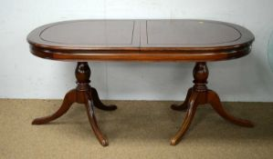 Asian mahogany extending twin-pedestal dining table; and a sideboard.