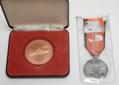 A 1936 German Olympic medal, and another