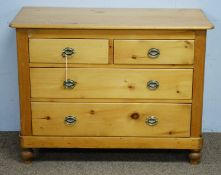 A Victorian stripped pine chest of drawers.