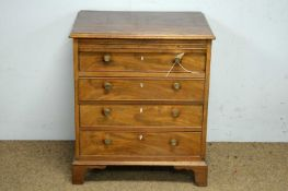 A mahogany four drawer chest.