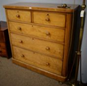 A Victorian ash chest of two short and three long drawers.