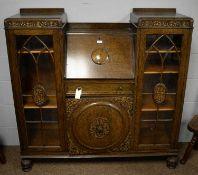 A mid 20th Century carved oak bureau bookcase.