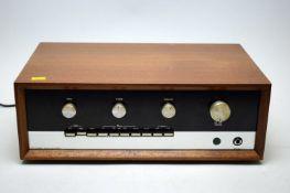 A Sugden A48 MK1 amplifier.