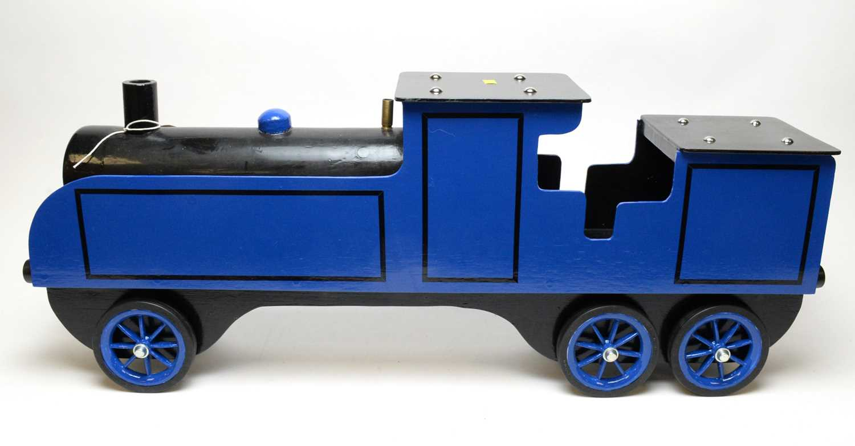 A wooden scratch-built sit-on locomotive.