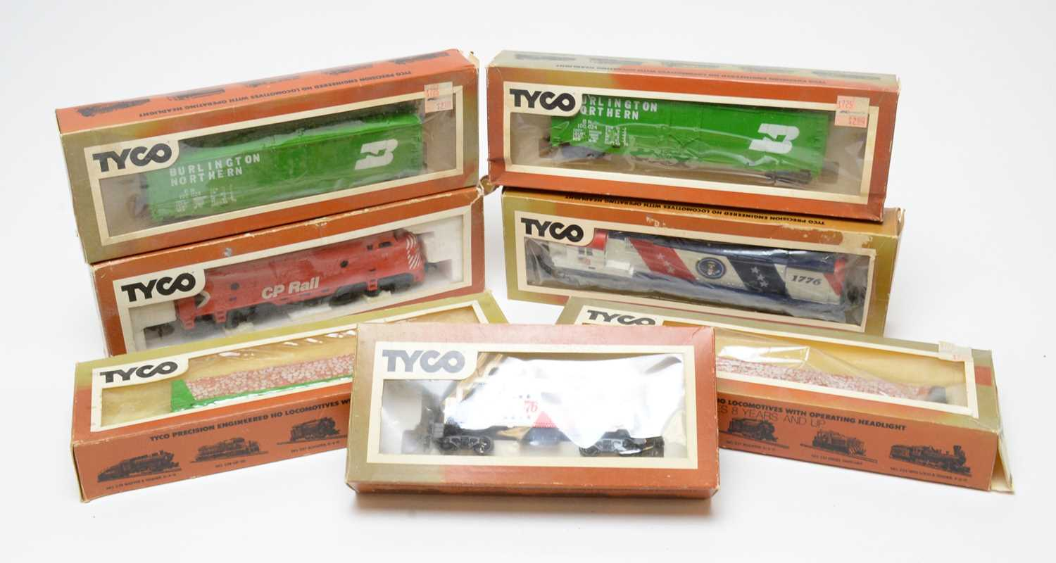 Seven boxed Tyco HO-gauge trains and rolling stock.