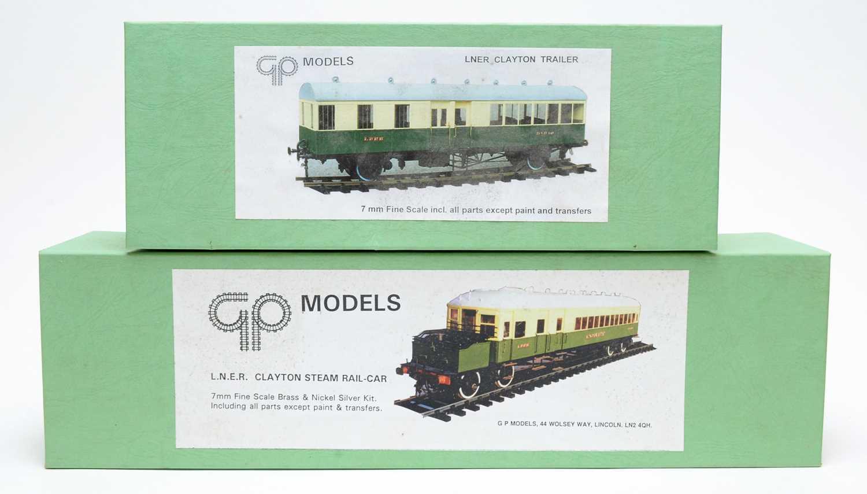 Two boxed GP model kits.