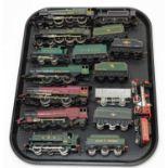 Nine 00-gauge unboxed locomotives and tenders.