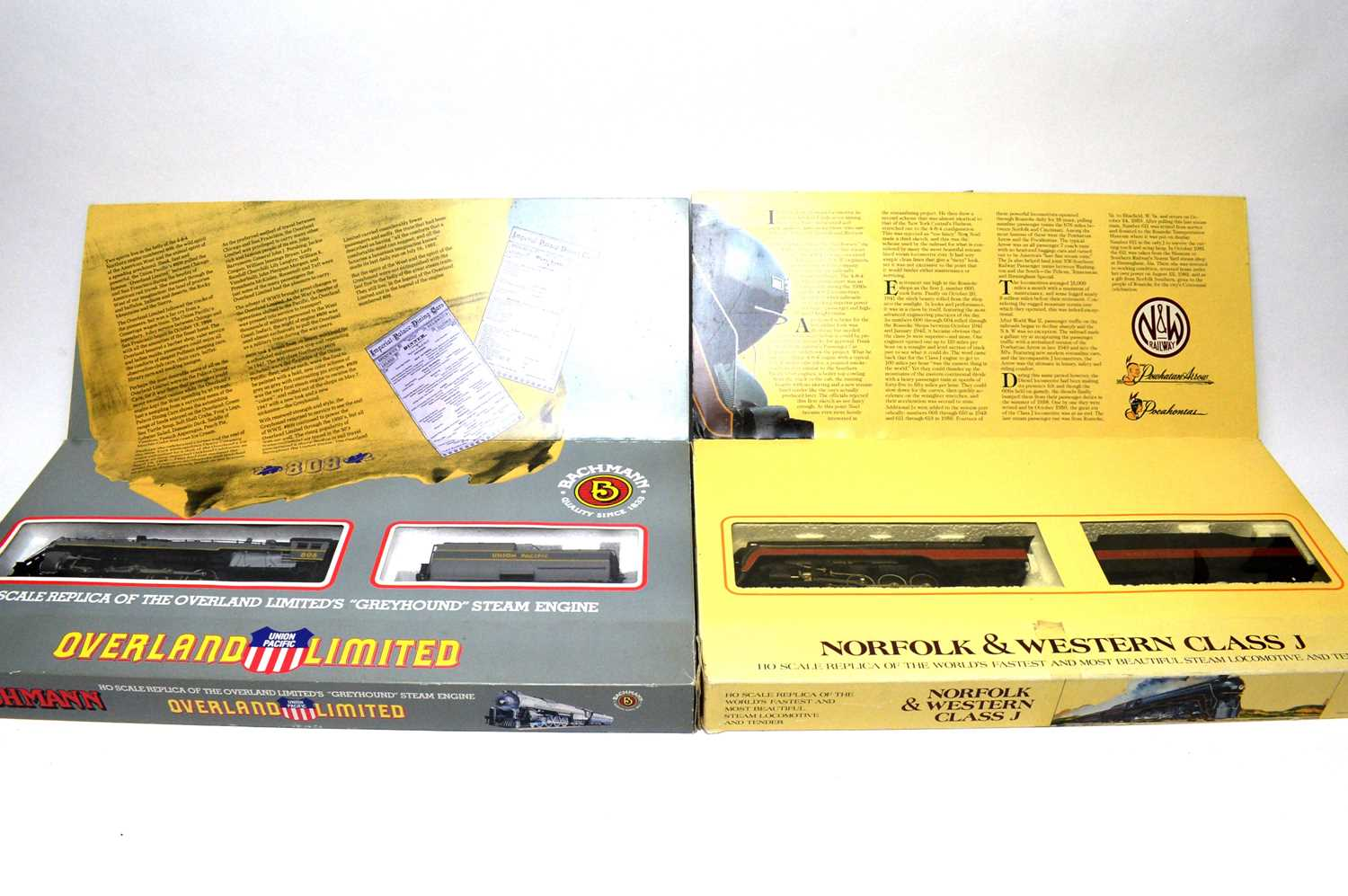 Two boxed Bachmann HO-gauge trains.