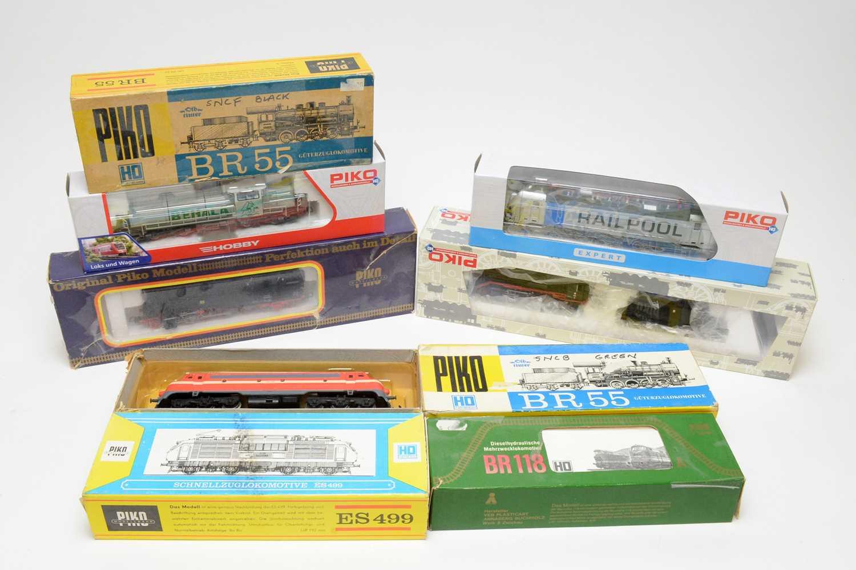 Nine Piko HO-gauge boxed trains.