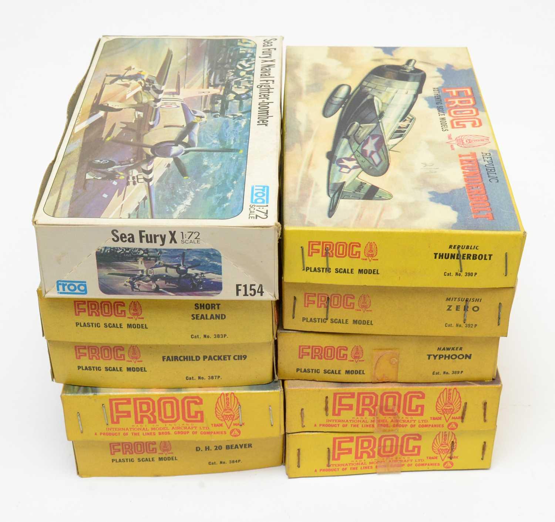 Ten boxed Frog model construction kits.