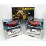 Boxed diecast scale model vehicles.