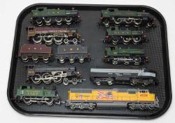 Nine 00/HO-gauge unboxed trains and tenders.