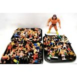 A collection of WWF and other action figures