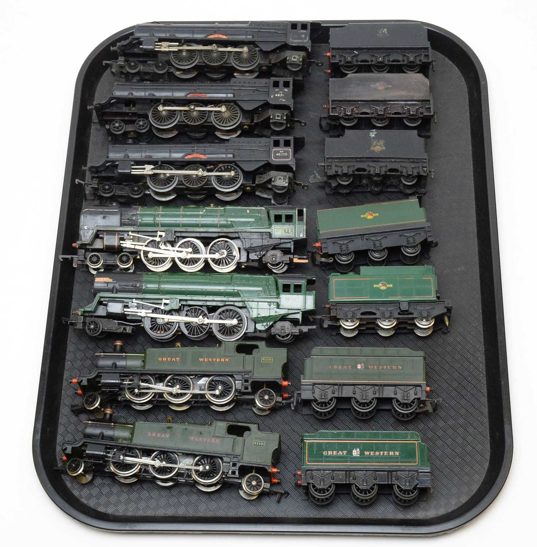 Seven 00-gauge unboxed locomotives and tenders.