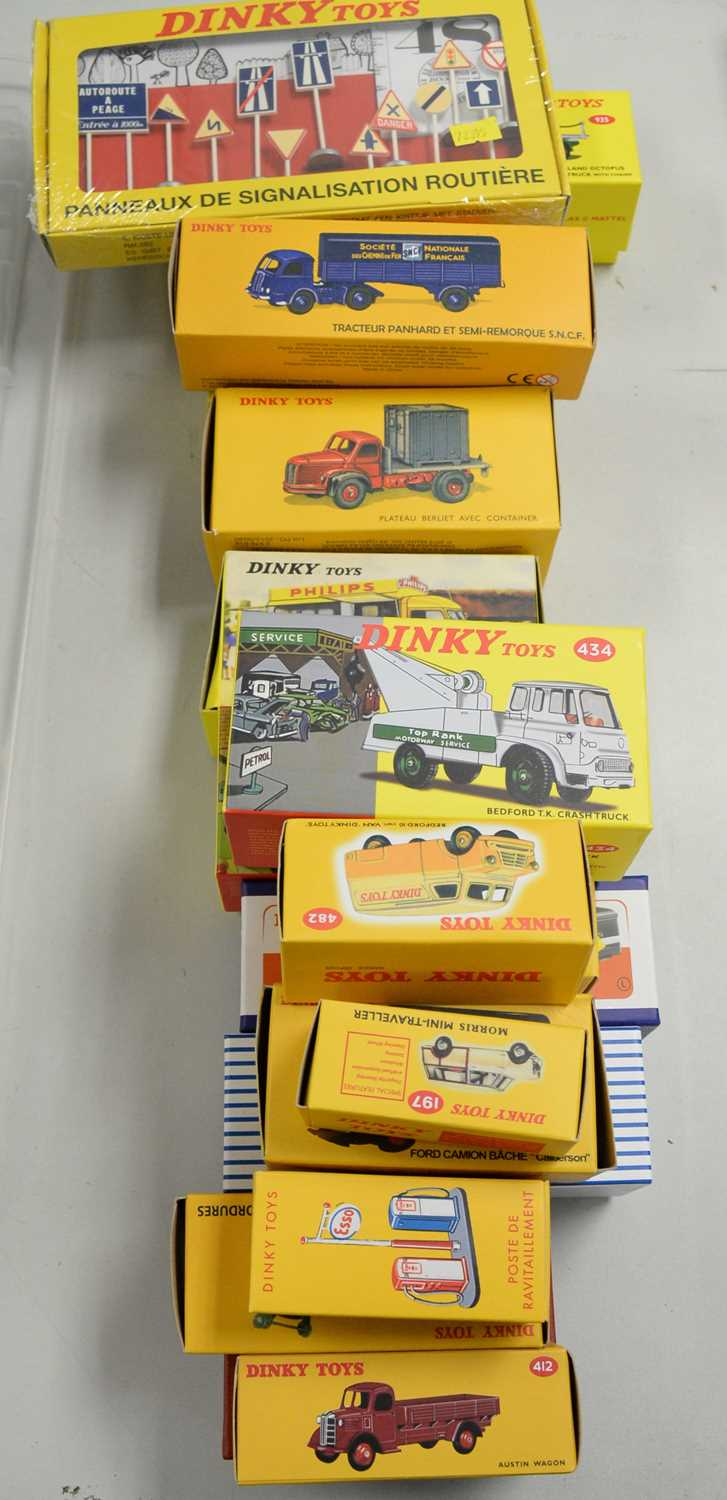 A collection of reproduction Dinky Toys diecast scale model vehicles.