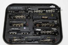 Seven unboxed locomotives and tenders,