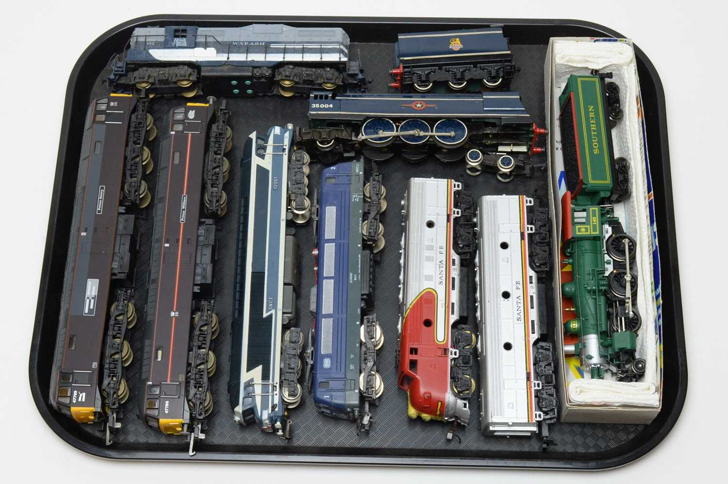 Eight 00/HO-gauge unboxed trains.