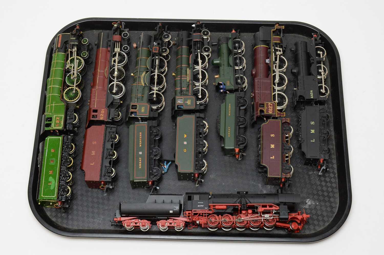 Eight unboxed locos.