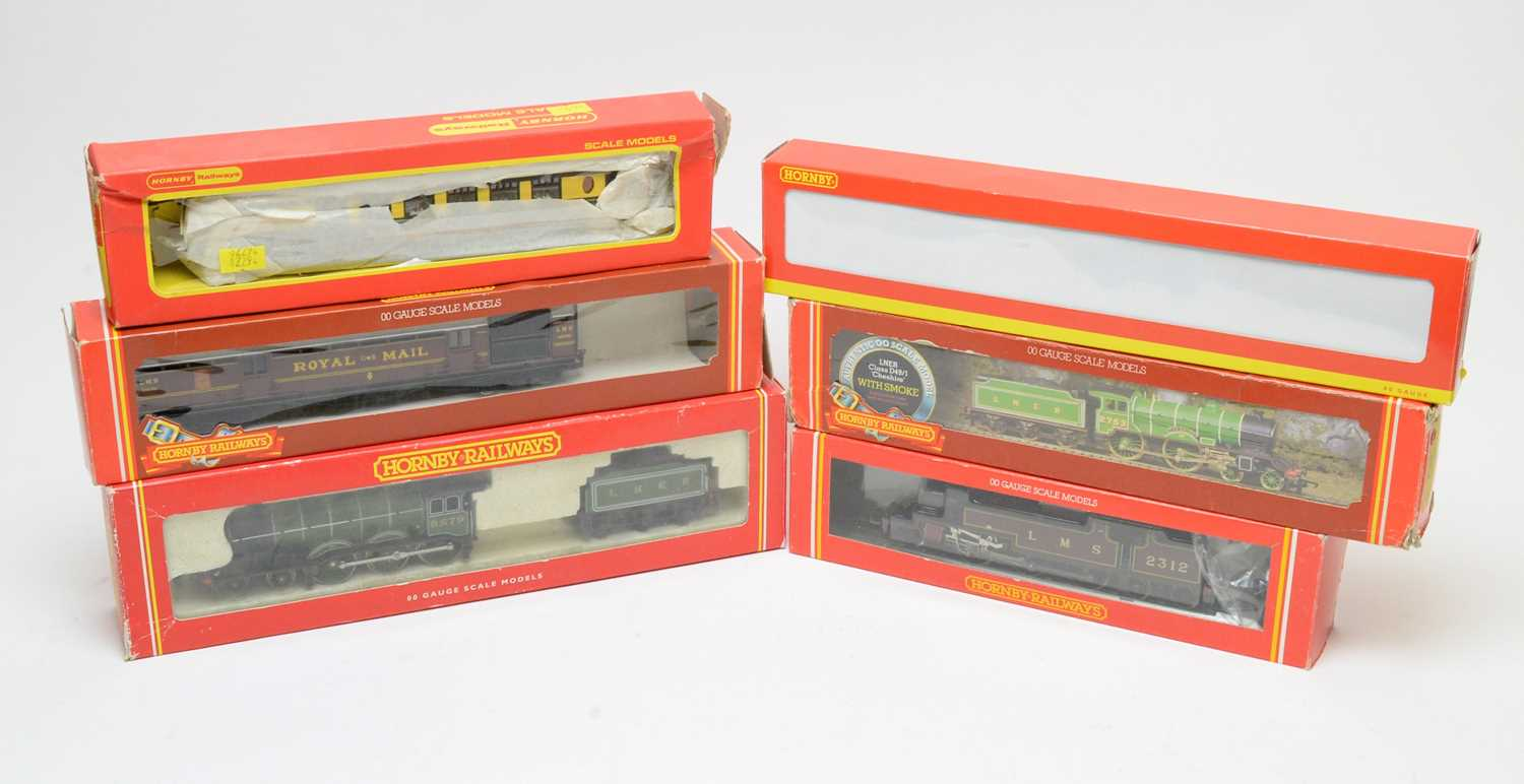 Six boxed Hornby Railways 00-gauge locomotives and carriages.