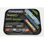 Nine unboxed trains, various makers.