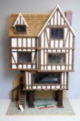 A three-storey Tudor-style doll's house.