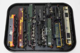 Nine unboxed locomotives