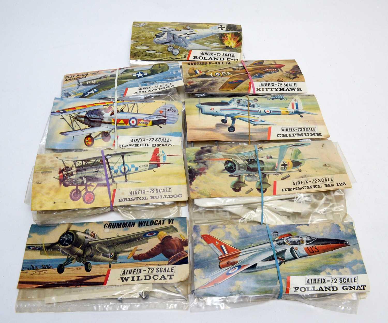 Nine early Airfix construction kits.