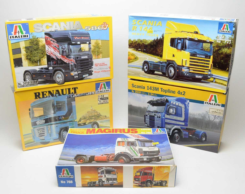 Five boxed Italeri scale model trucks.