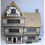 A Tudor-style doll's house by Robert Stubbs
