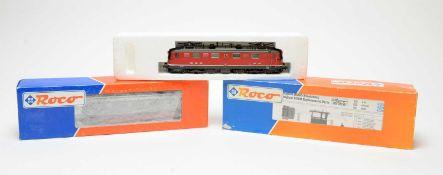 Three boxed Roco HO-gauge trains.