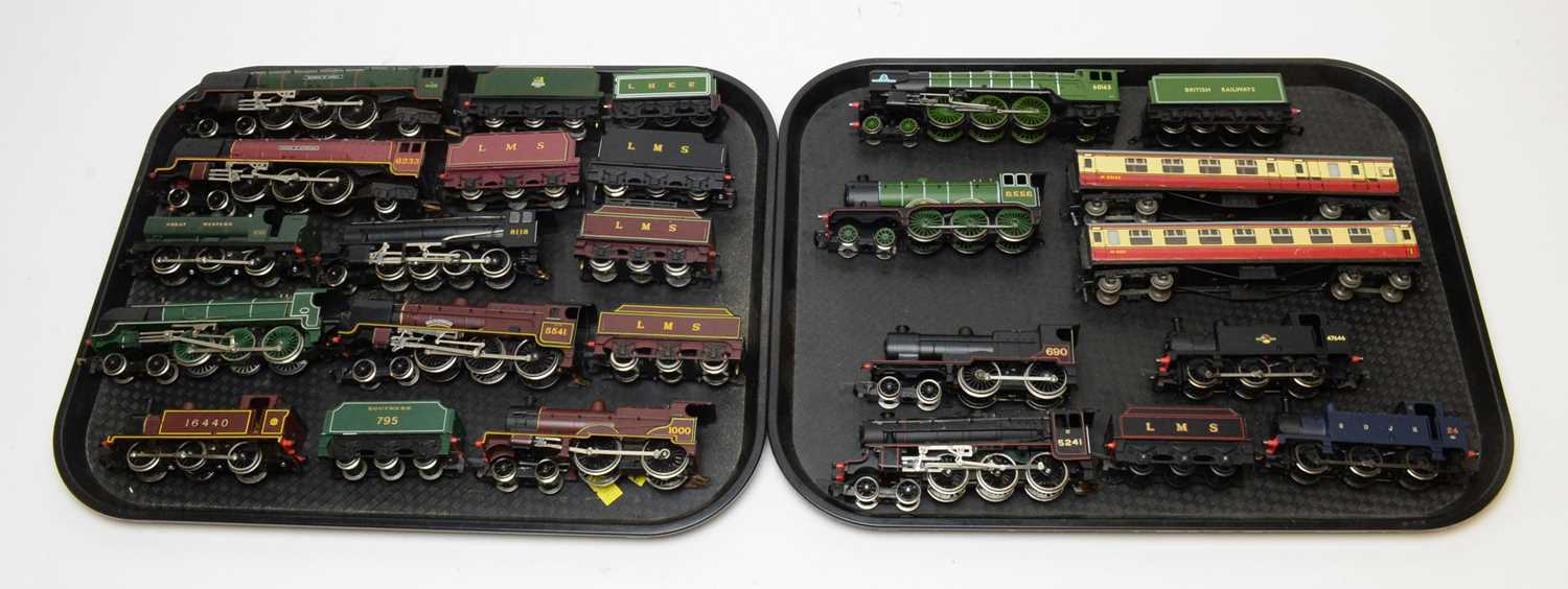Fourteen unboxed Hornby 00-gauge locomotives with tenders and carriages.