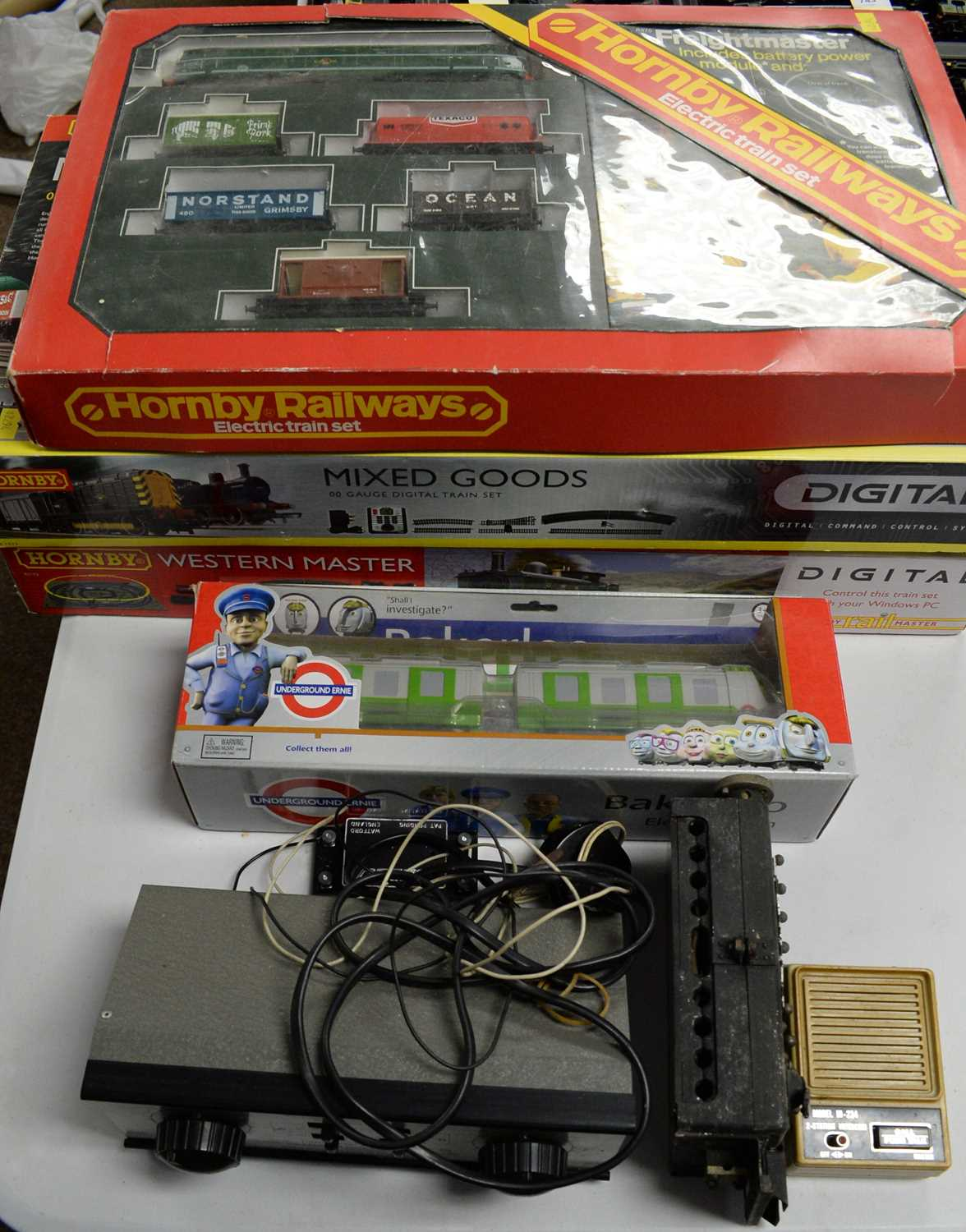 Three boxed Hornby 00-gauge trains sets, and other items.