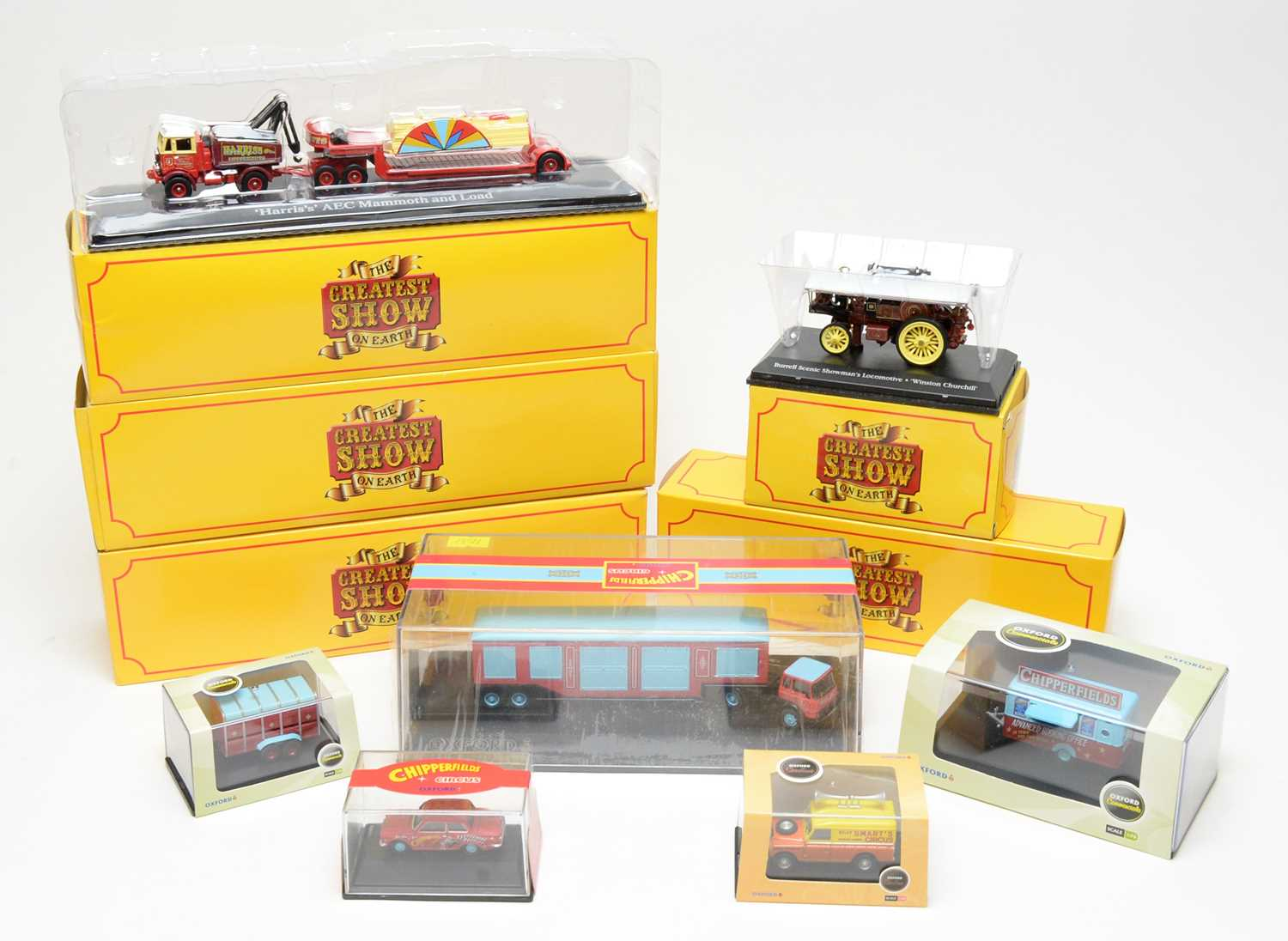 Boxed circus scale model vehicles.